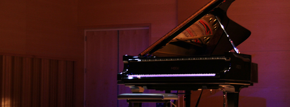 Photo of Fazioli piano on the Westermann Stage in the Concert Hall